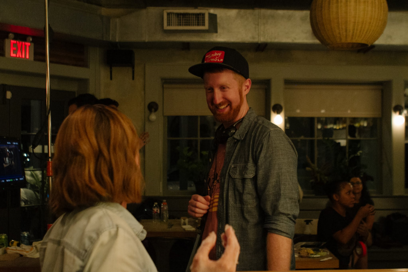 Erik and Emily discussing a scene.