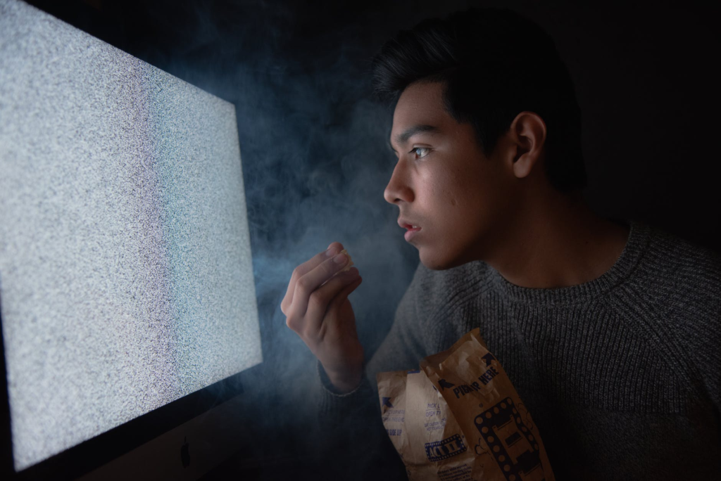 Image of a person starring at the TV screen