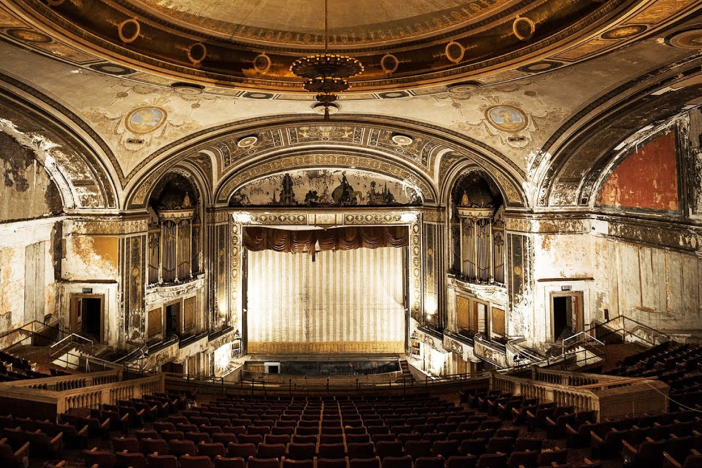 An abandoned ornate theater (as captured byThe Proper People)