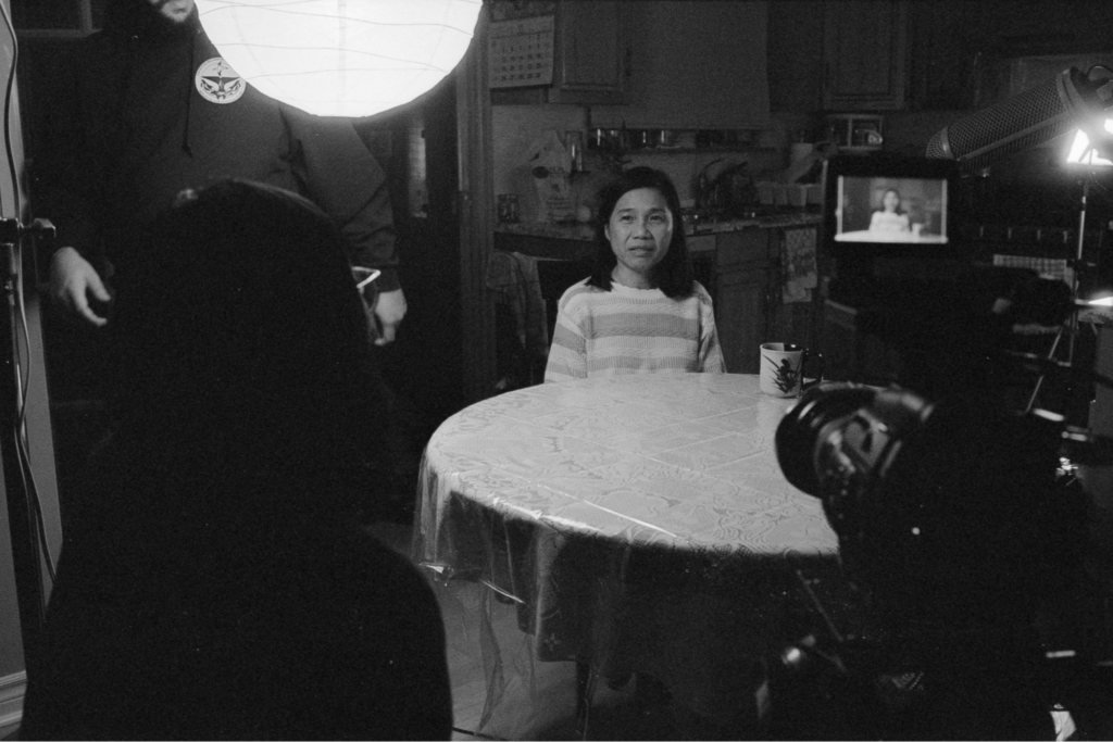 Carol Nguyen's mother prepares for an interview scene. (photo by Allen Bleich)